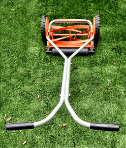 hand mower4: small lawn manual lawn mower on artificial lawn