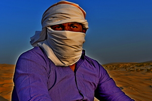 Indian man in the desert sand