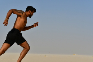 Runner on the sand in desert