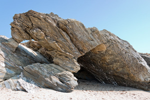 Rock arches: Sedimentary rock arches formed by wave erosion on a beach in Cornwall, England.