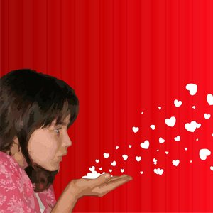 Girl blowing hearts