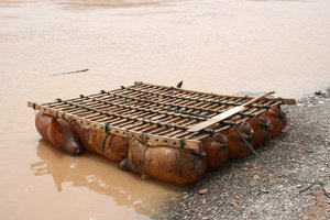 Raft: A raft made of inflated sheep skins lashed to a wooden framework, used to travel on the Yellow River, China.