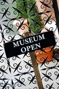 Museum Open Sign: Museum open sign with a 'dutch tilt'