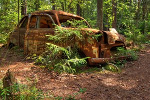 Disintegration - HDR: Old car left in a forest in Sweden. The picture is HDR using five images.