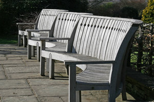 Benches: A series of curved ornamental benches in a park in England.