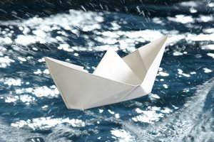 White Paper Boat: White paper boat on a rough blue sea