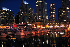Downtown Vancouver at Night 3: Lights on the water -- and full moon shining over the city taken on a holiday in Vancouver.  It was a challenge getting these shots, using everything from garbage cans to fire hydrants as