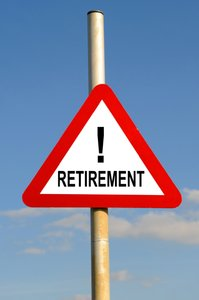 Retirement: Red warning triangle retirement concept