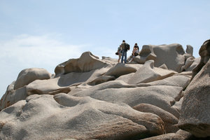 Tourists on sculpted rock