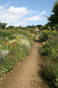 Garden path: Path through a large walled garden in West Sussex, England.
