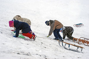 Children playing with sled 2