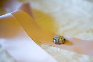 Rings: The wedding rings on the gown.