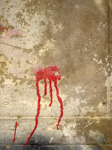 Blood: Red paint on a wall.