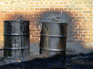 Oil Waste 1: Oil waste and barrels.