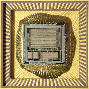 microchip: A digital application-specific integrated circuit, a research-chip developed at Lund University Sweden in the late 90's to be used for improving performance of mobile phone equipment transmitter power amplifiers. The silicon die in the middle measures som