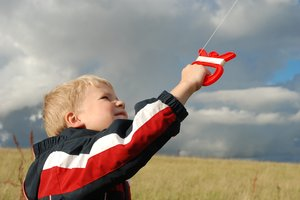 Kite Boy 4: Six years old boy flying a kite.