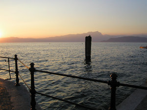 italy - lake garda: sunset in lazise, lake garda, italy