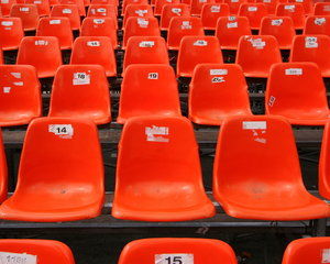 Red Seats: Close-up of red seats in a grandstand