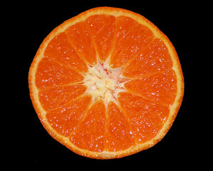 Mandarin: Macro shot of a cross section of a mandarin.