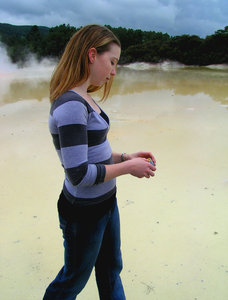 Girl walking over geothermal p