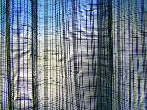 Net curtain: a dark blue net curtain contrasts with the daylight through the frosted glass window.  Possible overlay?
