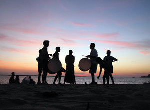 Drummers: Young band of drummers practice in the evening. The setting was surreal, an amazing sunset and nice beat & rhythm in the air.