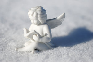 China angel at the winter: China decoration on the snow