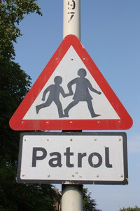 Children crossing 1: UK Warning sign for children cross a road