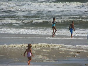 Kid's Beach: Children enjoying an Autumn day at the beach