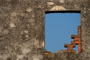 Wall opening: Window hole in old decayed wall.