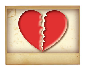 Broken Heart Pic: A vintage picture of a broken heart.Please visit my gallery at:http://www.thinkstockphot ..and:http://www.dreamstime.com ..