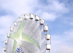 Ferris wheel: A ferris wheel in the sky.