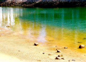Water Colours 2: Beautiful colours and reflections in shallow water near the coast.