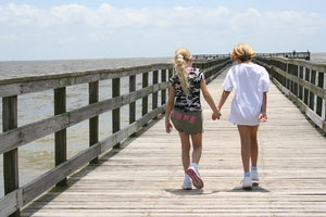 Hand in Hand: Walking down the dock