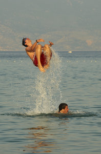 Young boys jumping in the sea: Young boys jumping in the sea, Baska, Croatia