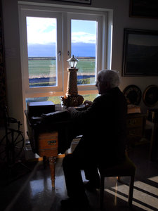 Old man: Old man sitting in the window and playing music