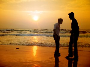 Beach friends 1: Silhouette of two friends on the beach