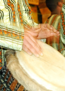Drummer: African Drumming on a Djembe drum.NB: Credit to read
