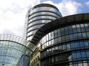 "round glass offices architectu: This one is called ""World Trade Center"" and is situated in Dresden, Germany"