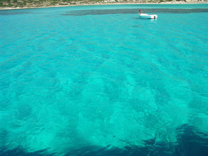 Blue water: Photos from Crete, Greece.The Blue Laguna. Fisherman working in his boat.