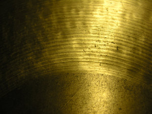 Brass Cymbal: This is a macro of a cymbal texture from and old drumset.