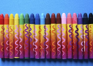 Crayons: wax coloring crayons on blue background