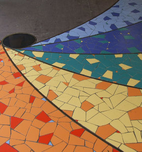 rainbow pavement: spiraling rainbow coloured pavement mosaic