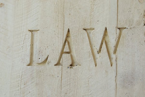 set in concrete: the word 'LAW' engraved/set in concrete