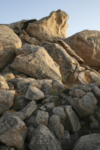 Boulders: A tumble of pink granitic boulders on the rocky coast of northwest Sardinia.