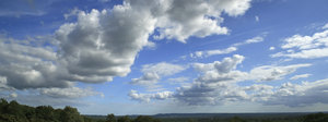 Surrey skies: View of summer cloud formations from Puttenham Common, Surrey, England. Three shot photomerge.