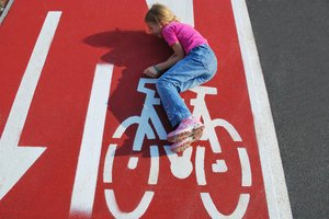 Kid fun on road marked bicycle