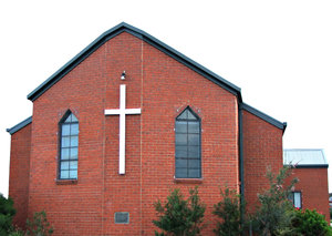 central cross: modern plain church building with central wall cross