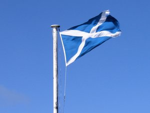scottish flag: the scottish flag flying in the wind.
