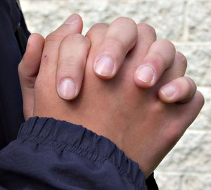 folding hands in prayer